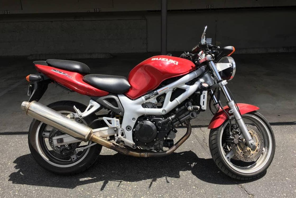 First-generation SV650, red. A great motorcycle to buy used.