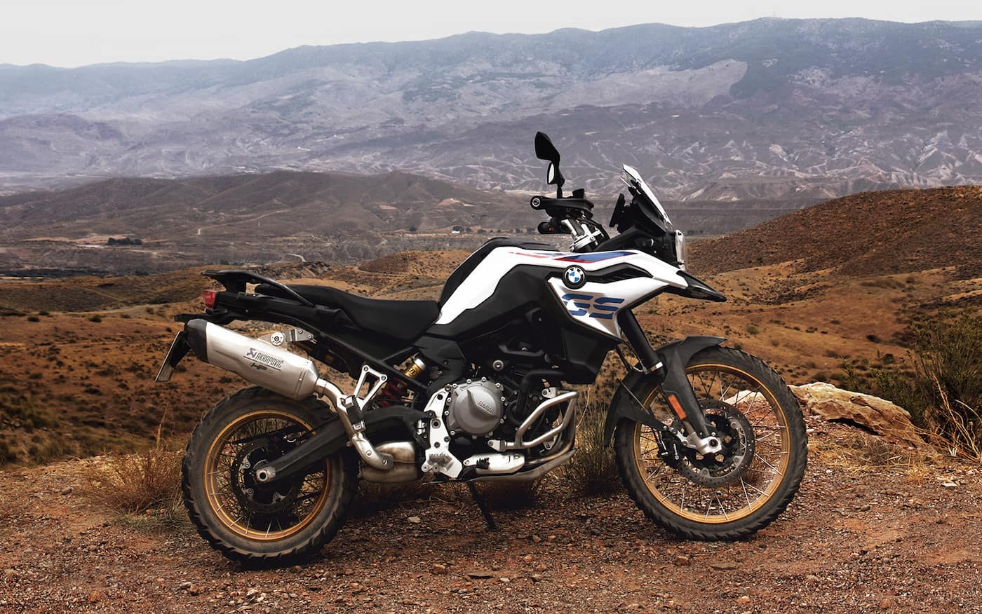 BMW F850GS in the wild on dirt with mountains