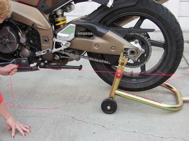 Checking frame alignment with string on a motorbike