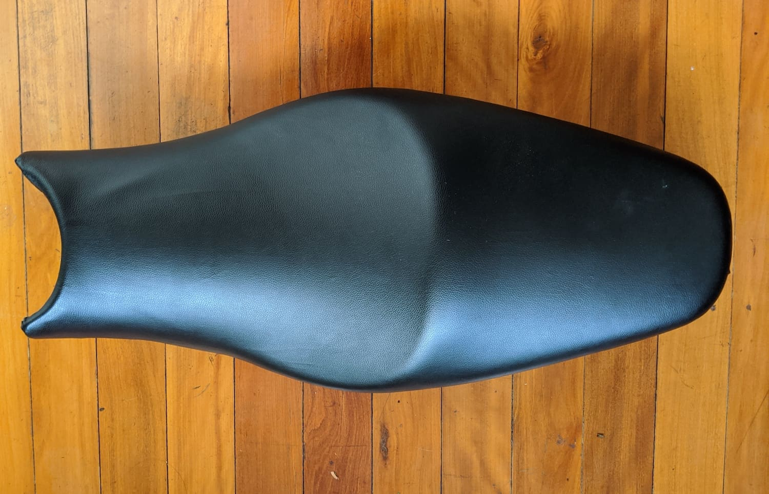 The final re-upholstered motorcycle seat — nearly perfect!