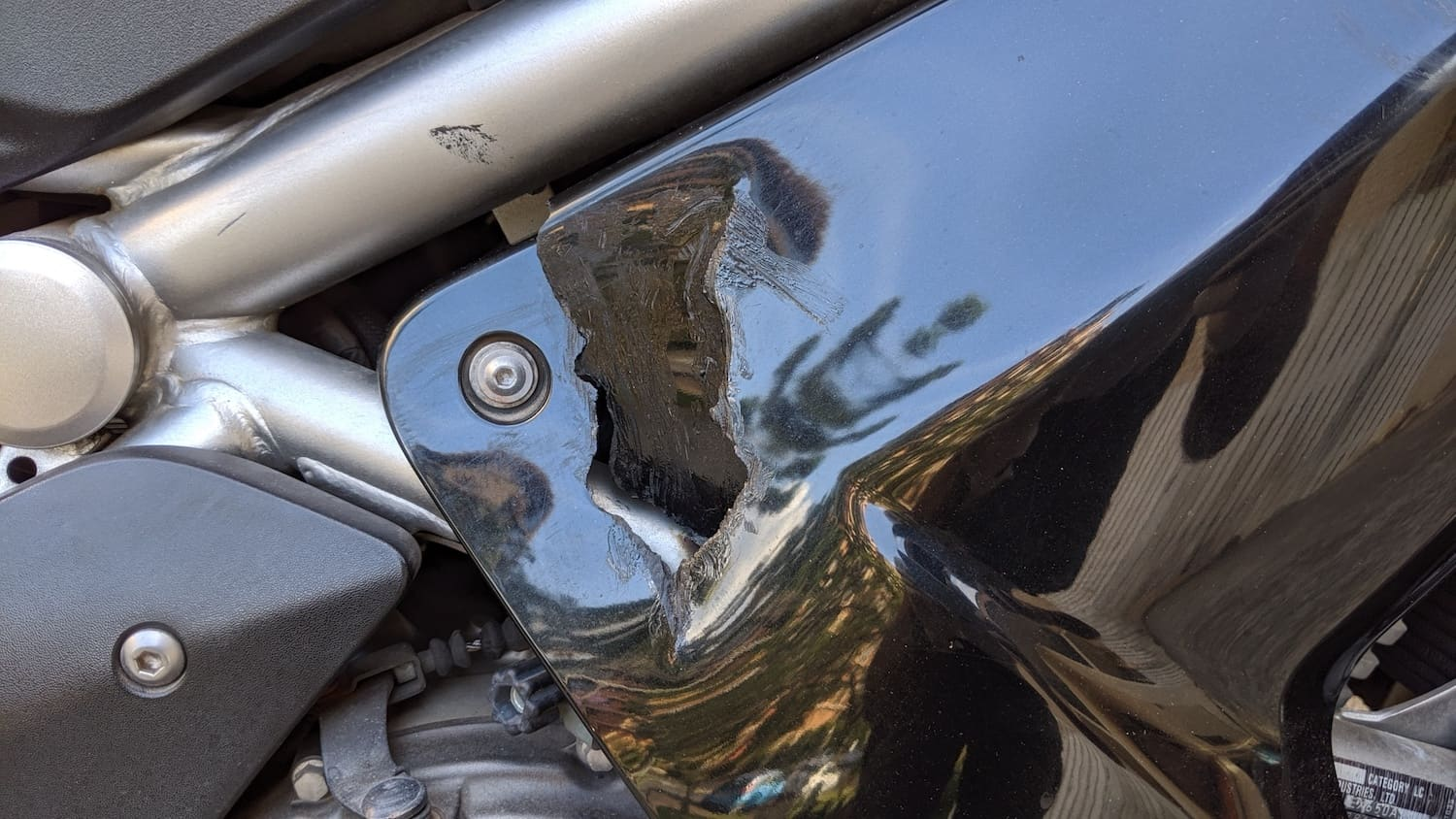 hole in motorcycle fairing that needs to be repaired.