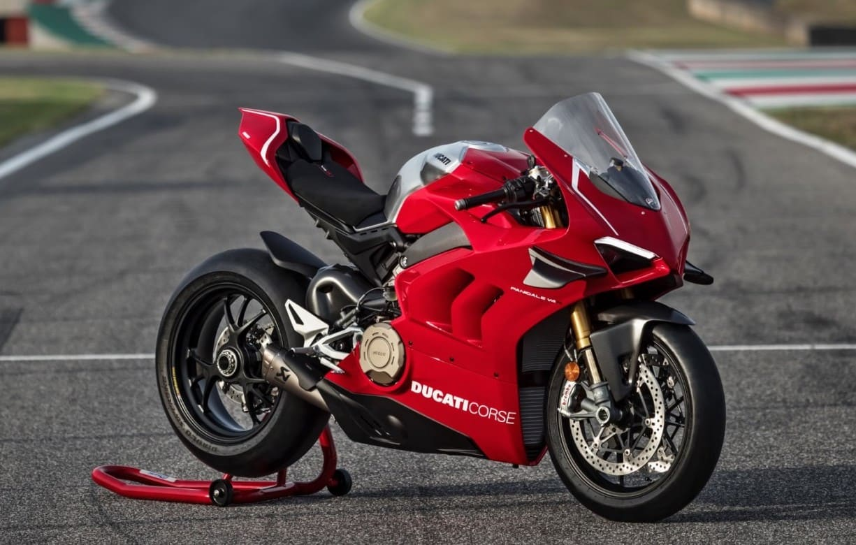 Actual Ducati Panigale V4R, not the Lego version. ON race track, side view.