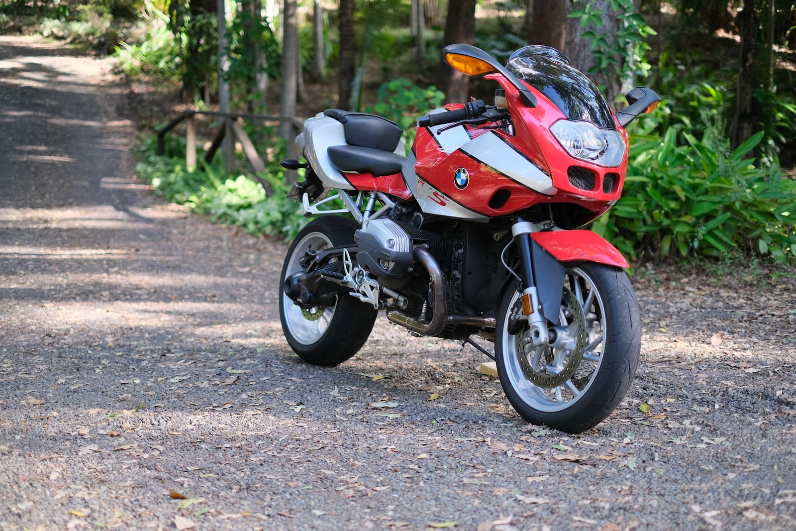 BMW R1200S in red and silver - side view on a dirt road