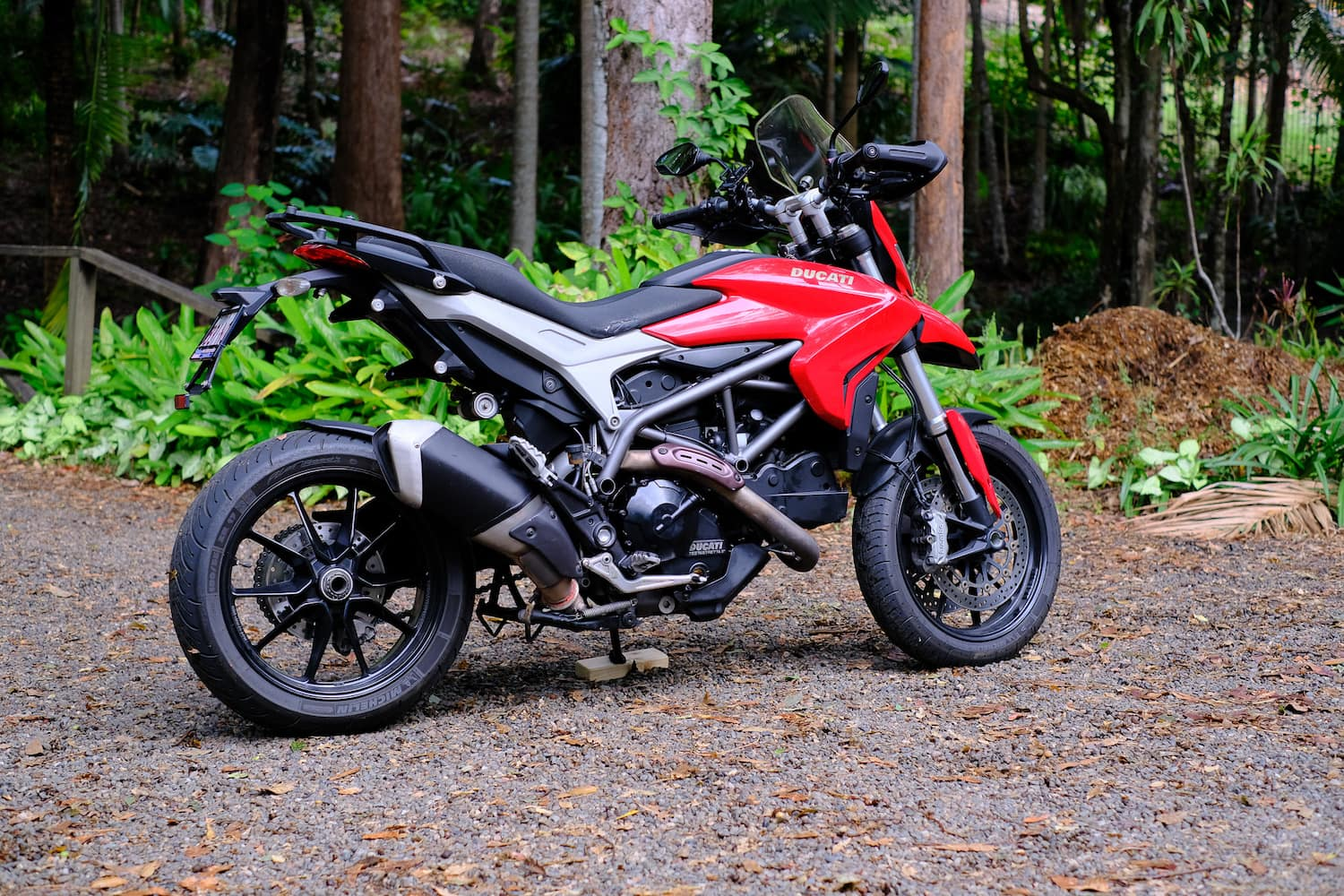 Red ducati hyperstrada 821 with a stock exhaust.