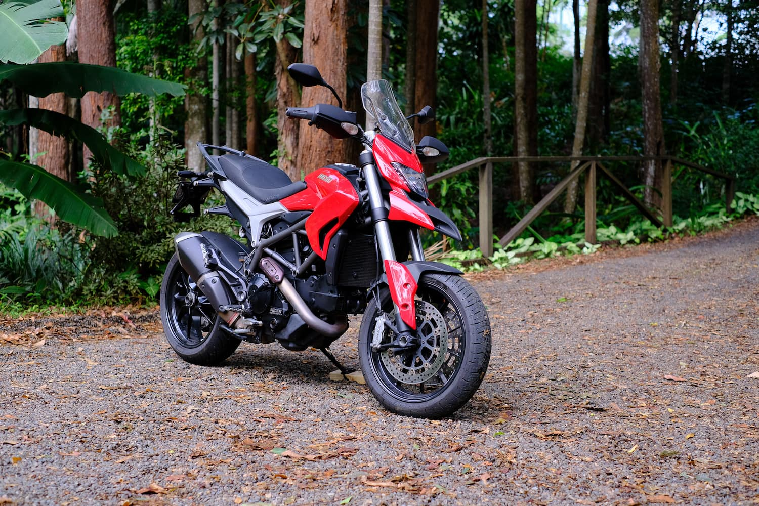 Ducati Hyperstrada 821 red - side view on dirt road