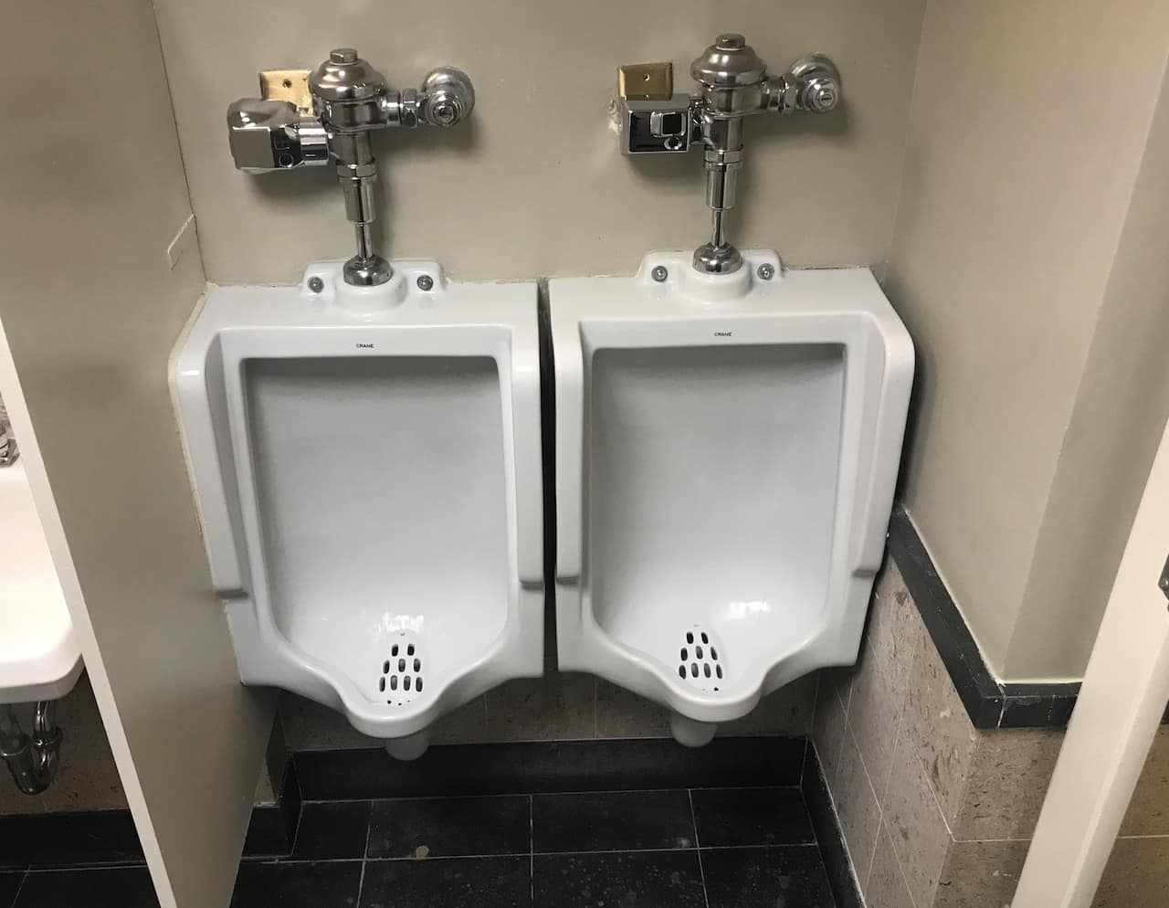 Urinals too close together at Bain & Co