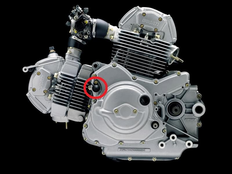 Location of the crankshaft position sensor (or timing sensor) on a Ducati motorcycle engine