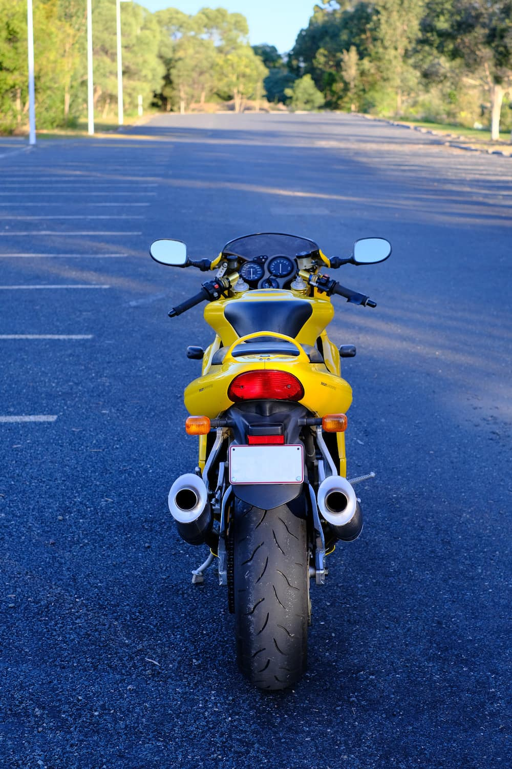 Yellow Ducati Supersport 900 fuel injected from the rear