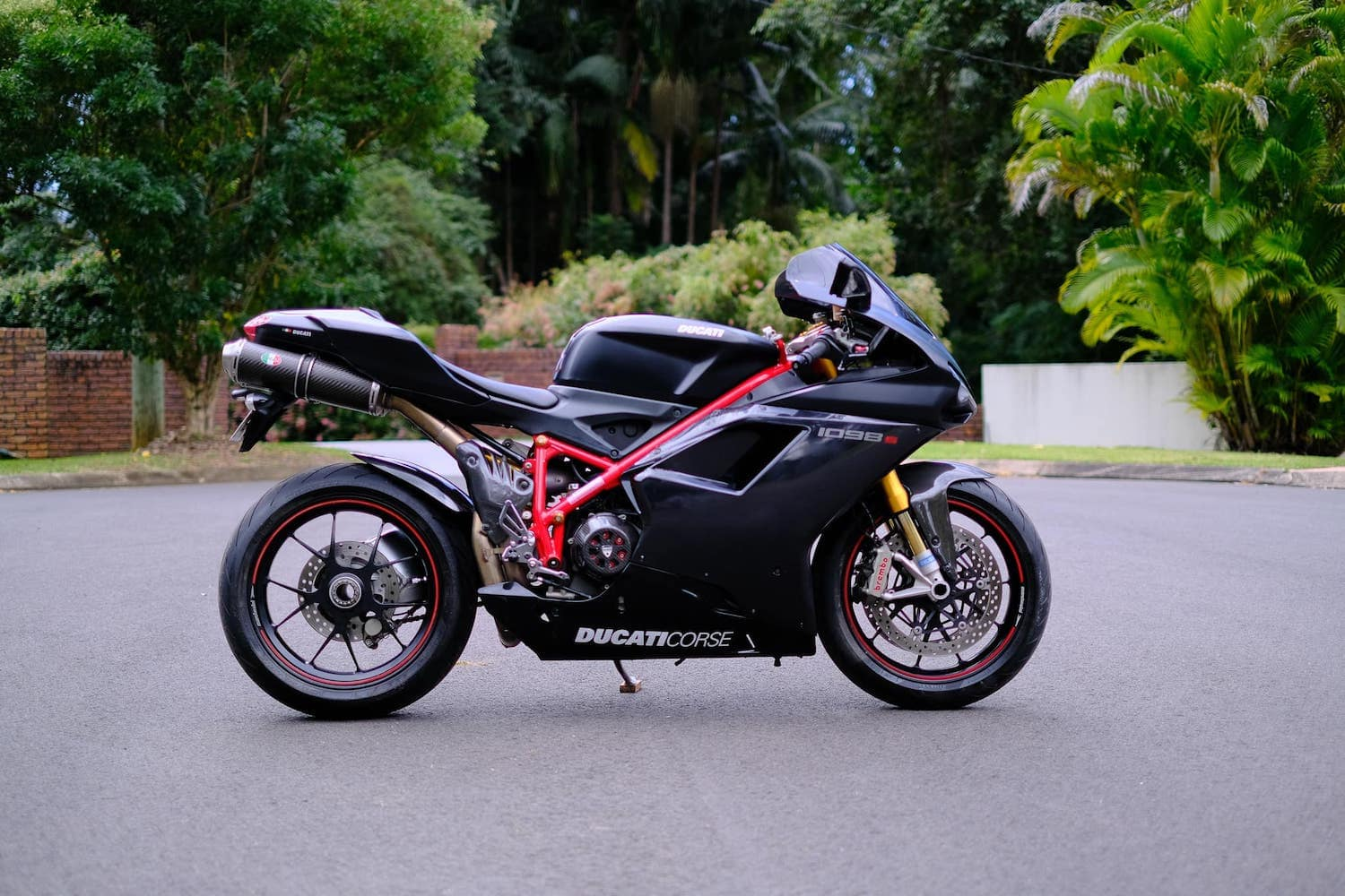 Black ducati 1098S, side on. single-sided swing-arm