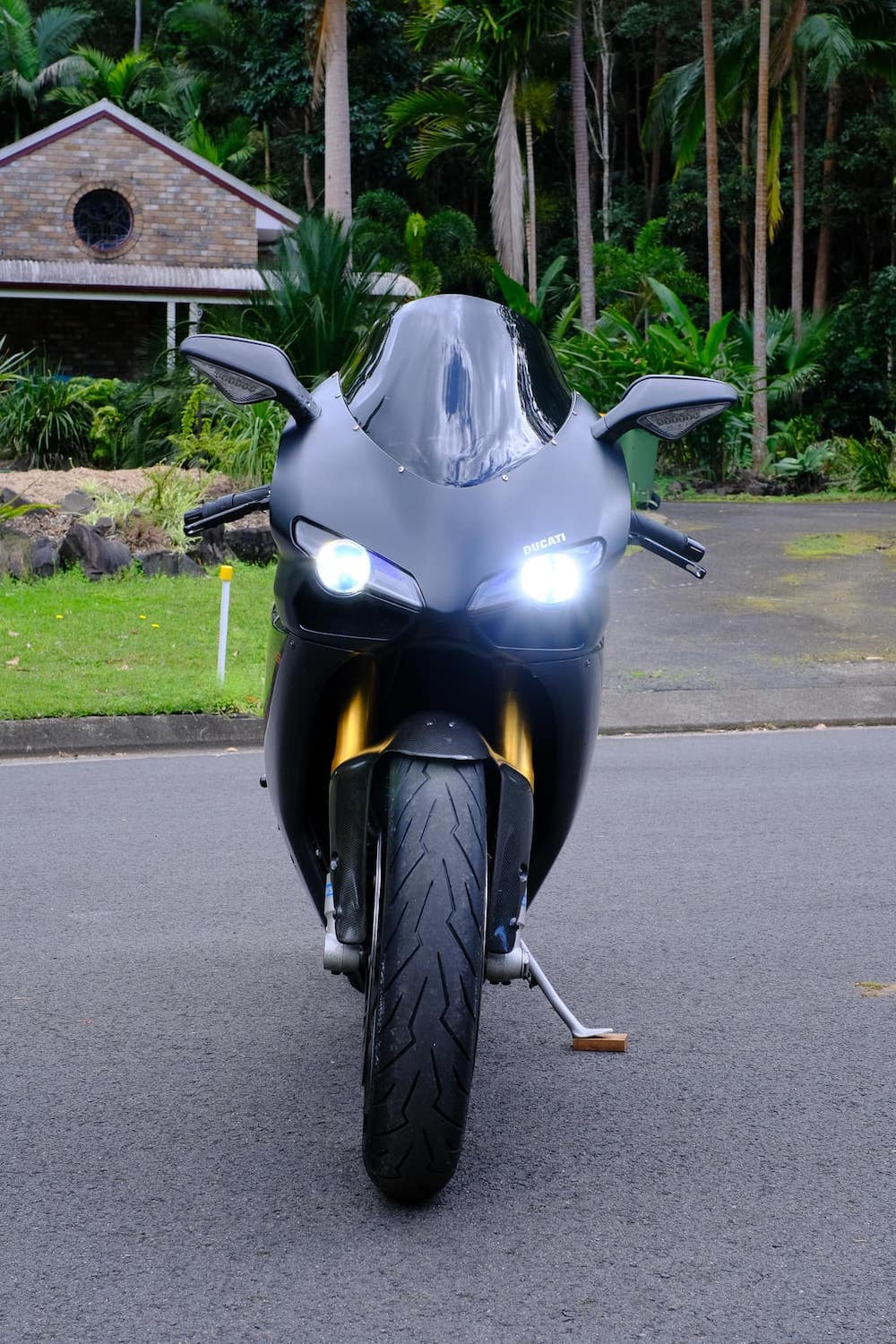 Front view of a Ducati 1098S with both low beam and high beam headlight on