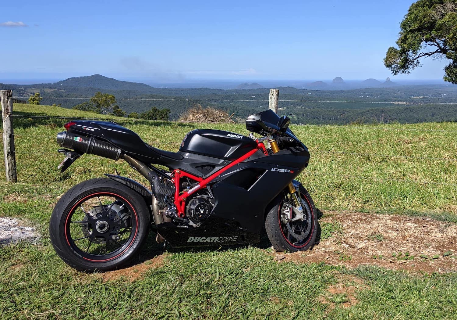 Side view of Ducati 1098S riding into mountains in Australia