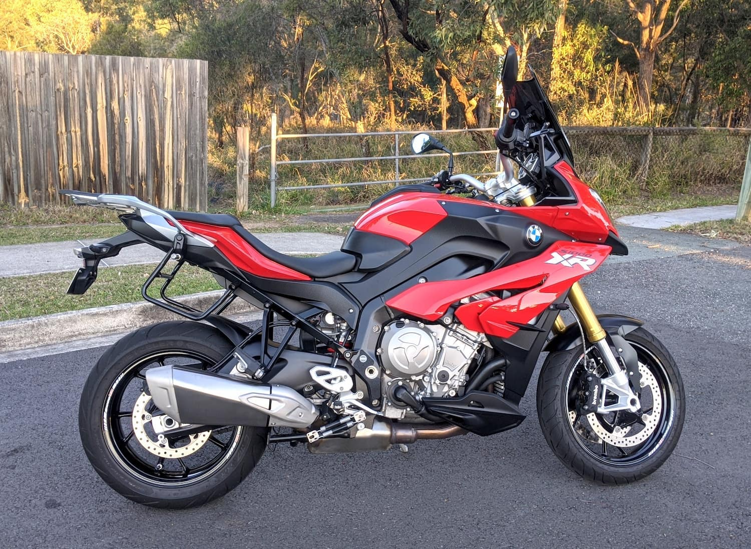 Red BMW S1000XR with buzzy handlebars